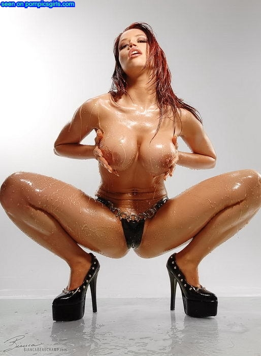 oil-stunning-red-head-with-very-sexy-body-grabing-her-big-round-boobs-in-leather-lingerie-and-high-heel-getting-herself-oiled